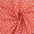 Tissu en coton imprimé sur fond corail