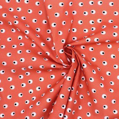 Tissu en coton imprimé oeufs durs sur fond corail