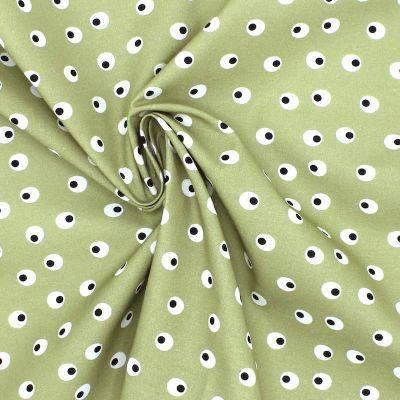 Tissu en coton imprimé oeufs durs sur fond kaki