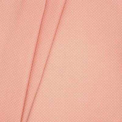Coton enduit à pois sur fond rose