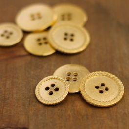 Boutons en métal doré