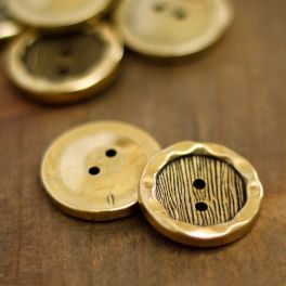 Round button with metal aspect - gold