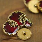 Bouton rond en résine aspect métal doré et émaille rouge grenat