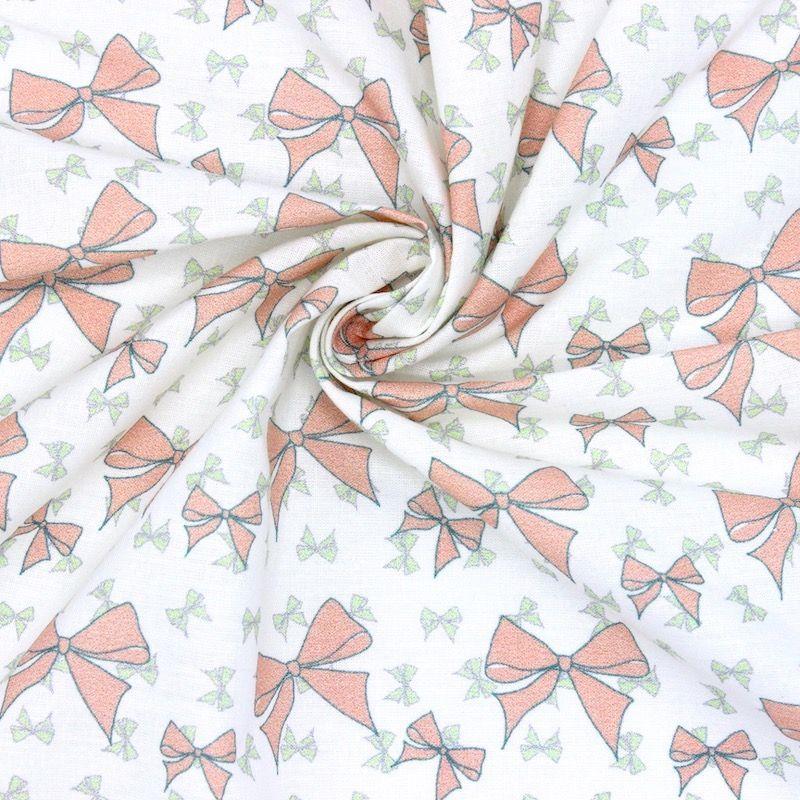 Cretonne bedrukt met roze strikjes
