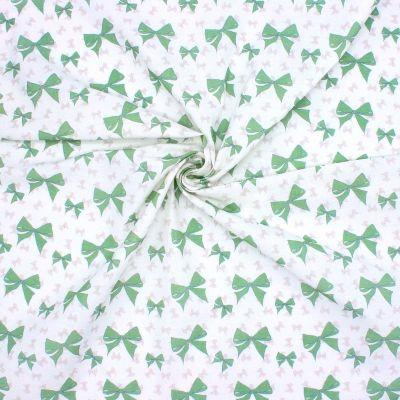 Cretonne bedrukt met groene strikjes