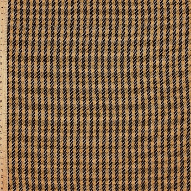 Tissu vestimentaire beige à carreaux