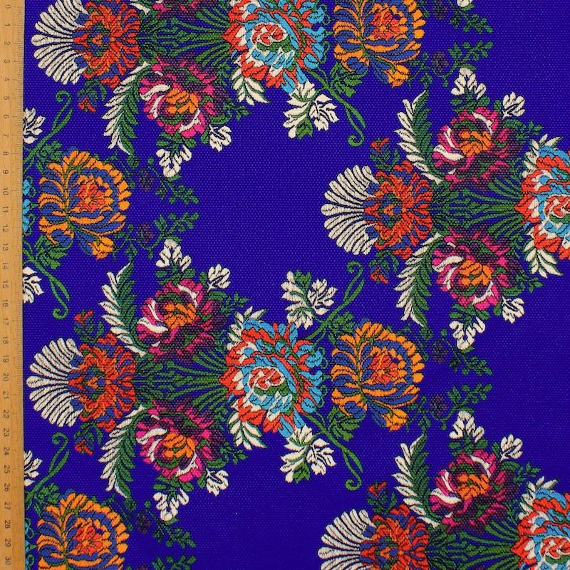 Fabric printed with flowers - blue background