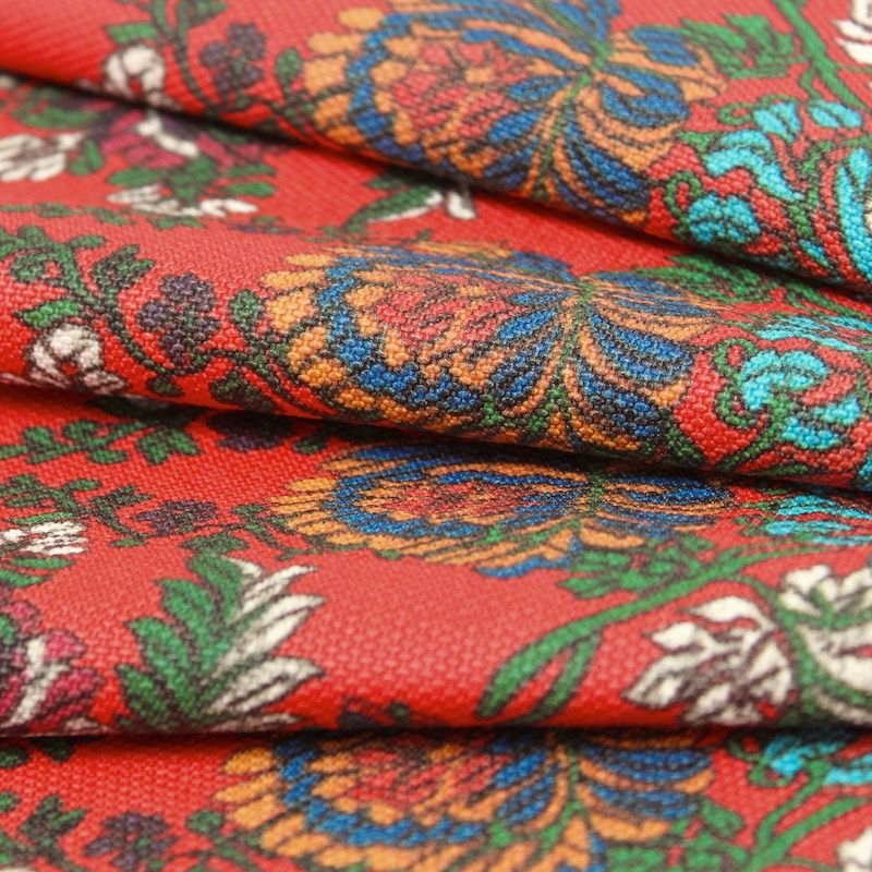 Fabric printed with flowers - red background