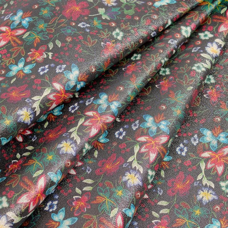 Fabric printed with flowers with silver reflection