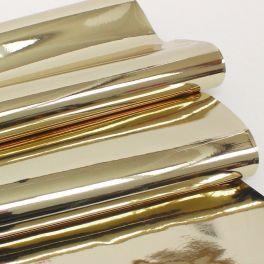 Tissu raide effet miroir doré