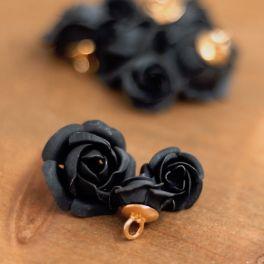 Knoop in hars met vorm van een bloem - zwart