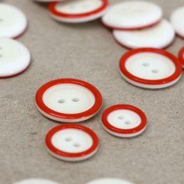Bouton en résine blanc cassé et rouge