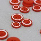 Bouton en résine rouge et blanc