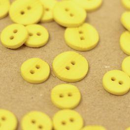 Bouton fantaisie en résine jaune citron