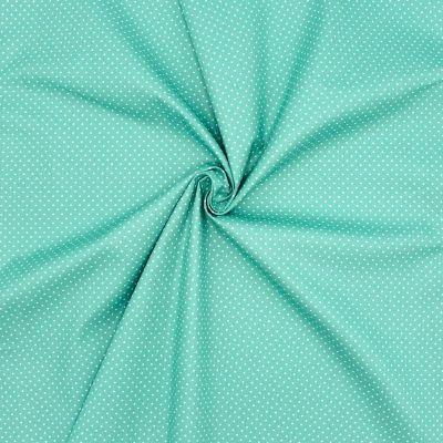 Tissu en coton à pois sur fond turquoise