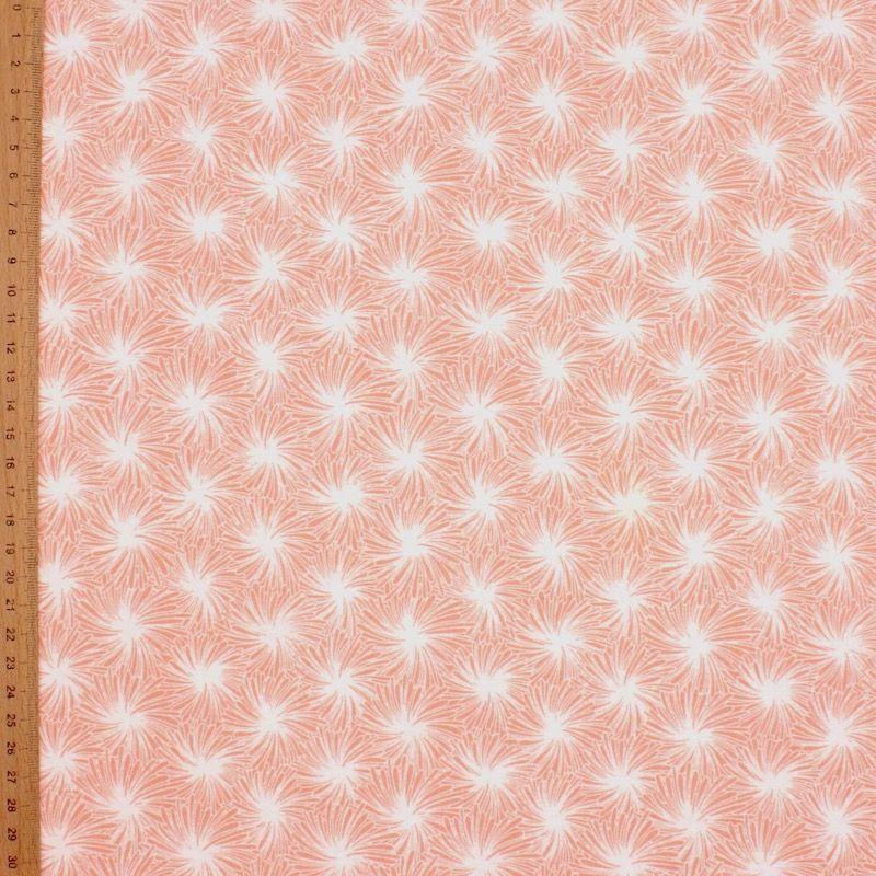 Tissu en coton rose à motif floral