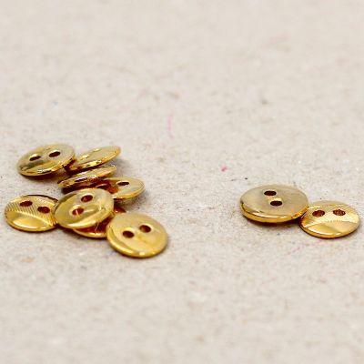 Bouton aspect métal doré