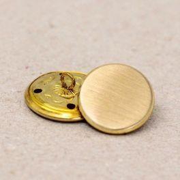 Bouton en métal poli doré