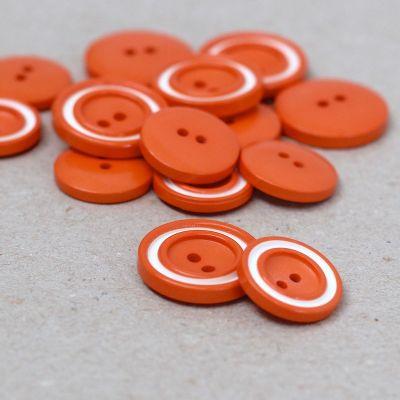 Bouton en résine orange et blanc