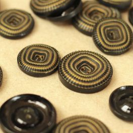 Vintage knoop in hars - zwart en goudgeel