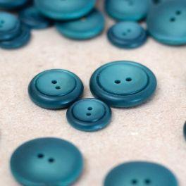Bouton en résine bleu pétrole