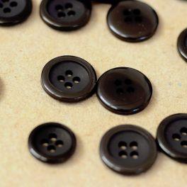 Bouton rond à 4 trous résine noir
