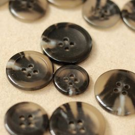 Button with ornament - transparent and black