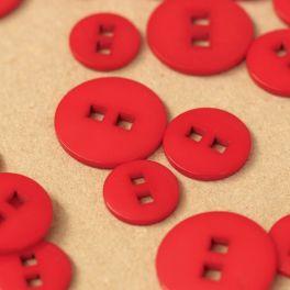 Bouton en résine rouge