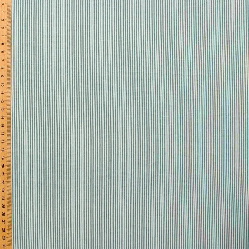 Tissu en coton à lignes vertes sur fond blanc