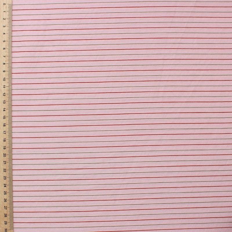 Tissu en coton et polyester à lignes rouge et brun sur fond rose