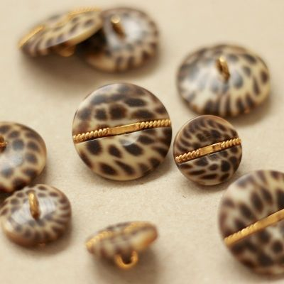 Bouton léopard brun et doré