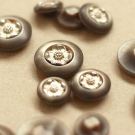 Resin pearly button with silver flowers