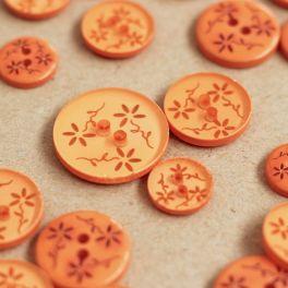 Bouton rond à fleurs en résine orange semi transparent
