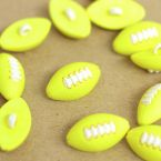 Bouton ballon de rugby jaune et blanc