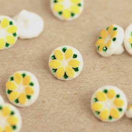 Knoop in hars met bloem - geel en wit