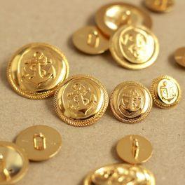 Vintage knoop in gouden metaal met anker