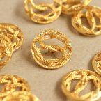 Bouton vintage en métal doré