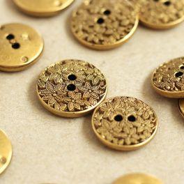 Vintage knoop met bloemen in lichte metaal - oud goud