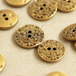 Vintage light metal button with flowers - old gold