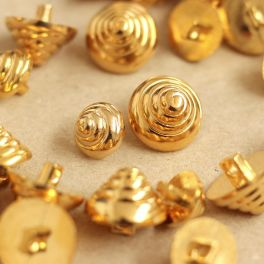 Cone-shaped button with golden metal aspect