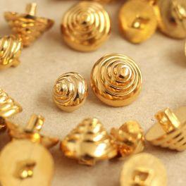 Vintage kegel knoop met gouden metaal aspect