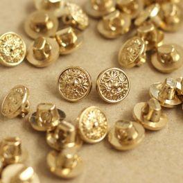 Vintage knoop met gouden metaal aspect