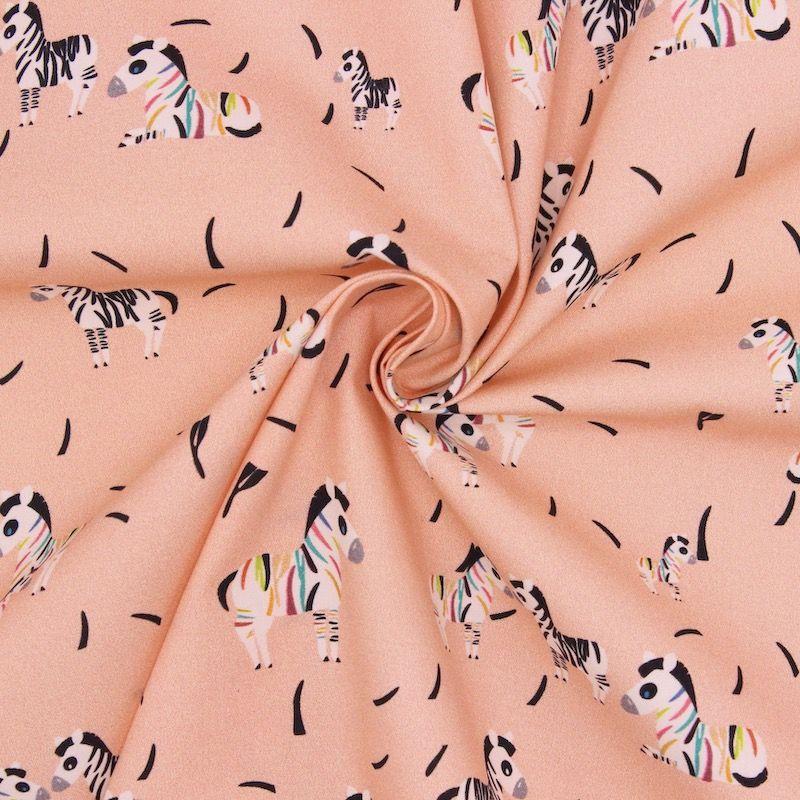 Poplin of cotton with zebras - salmon pink