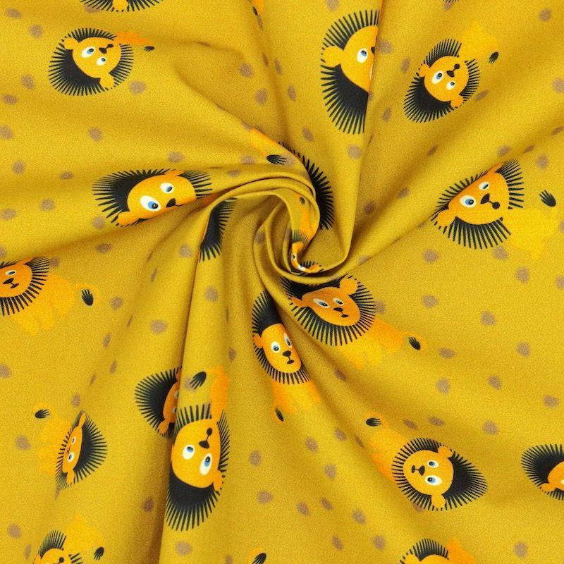Popeline van katoen met leeuwen - mosterdgeel