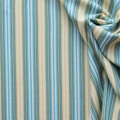 Katoenstof met blauwe en groene strepen op een witte achtergrond