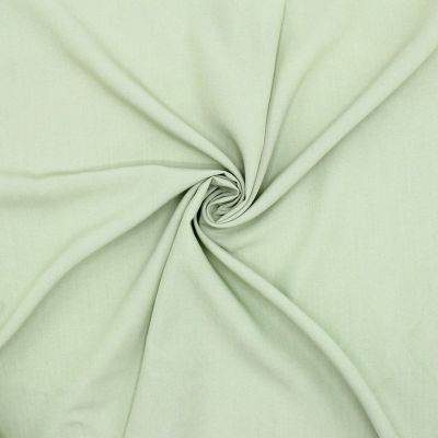 Fabric in viscose and polyester - almond green
