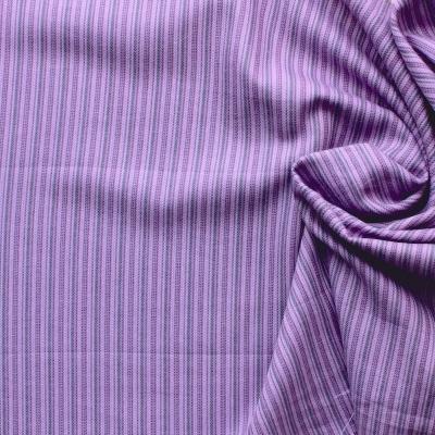 Geborsteld katoen met paarse strepen