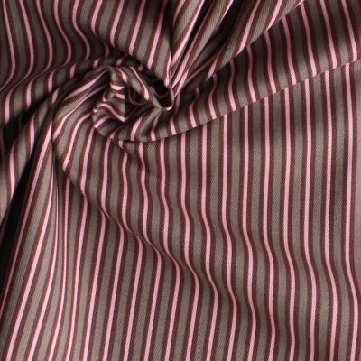 Tissu en coton à lignes rose et rouge sur fond brun