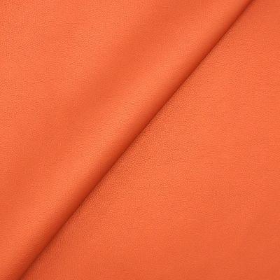 Simili cuir orange brûlée satiné
