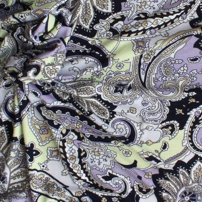 Jersey stof met paarse en gele bloemen